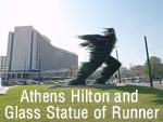 start here; the Hilton Hotel and the plate glass   angst filled statue outside